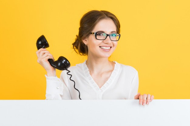 portrait-young-business-woman-with-telephone-showing-blank-billboard-yellow-wall_88135-4331